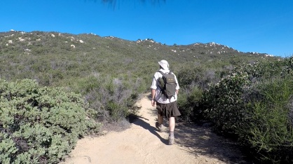 AJ hiking away in kilt